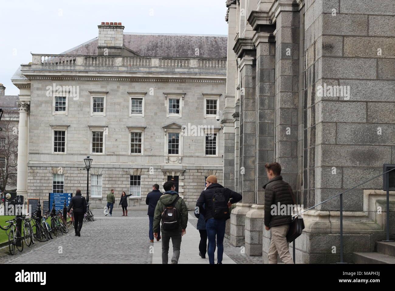 students gathering around trinity university college in Dublin Ireland. - Stock Image
