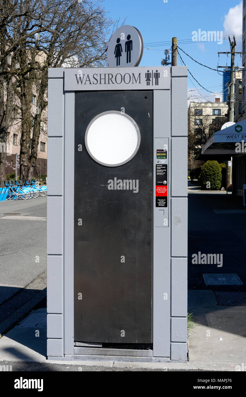 Outdoor public washroom street cubicle in downtown Vancouver, BC, Canada - Stock Image