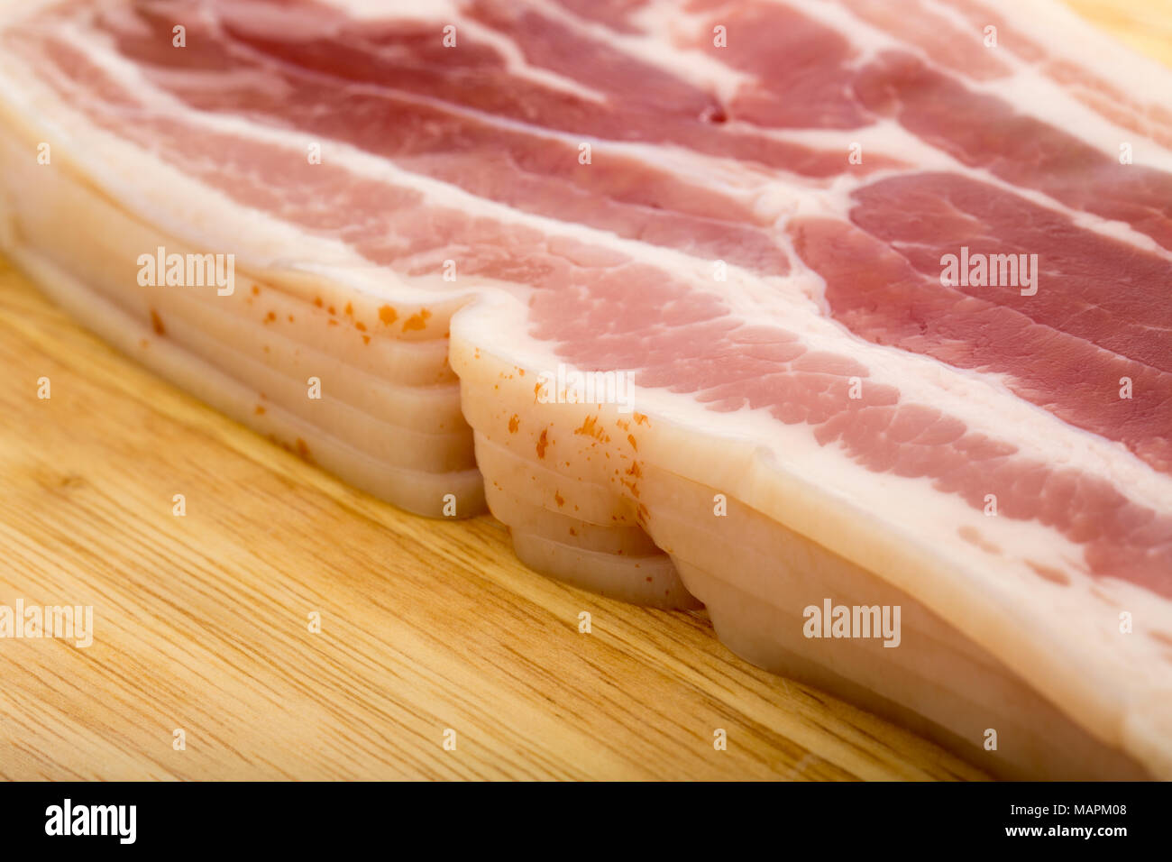 Unsmoked rashers of streaky bacon produced in the EU from a supermarket. Dorset England UK - Stock Image