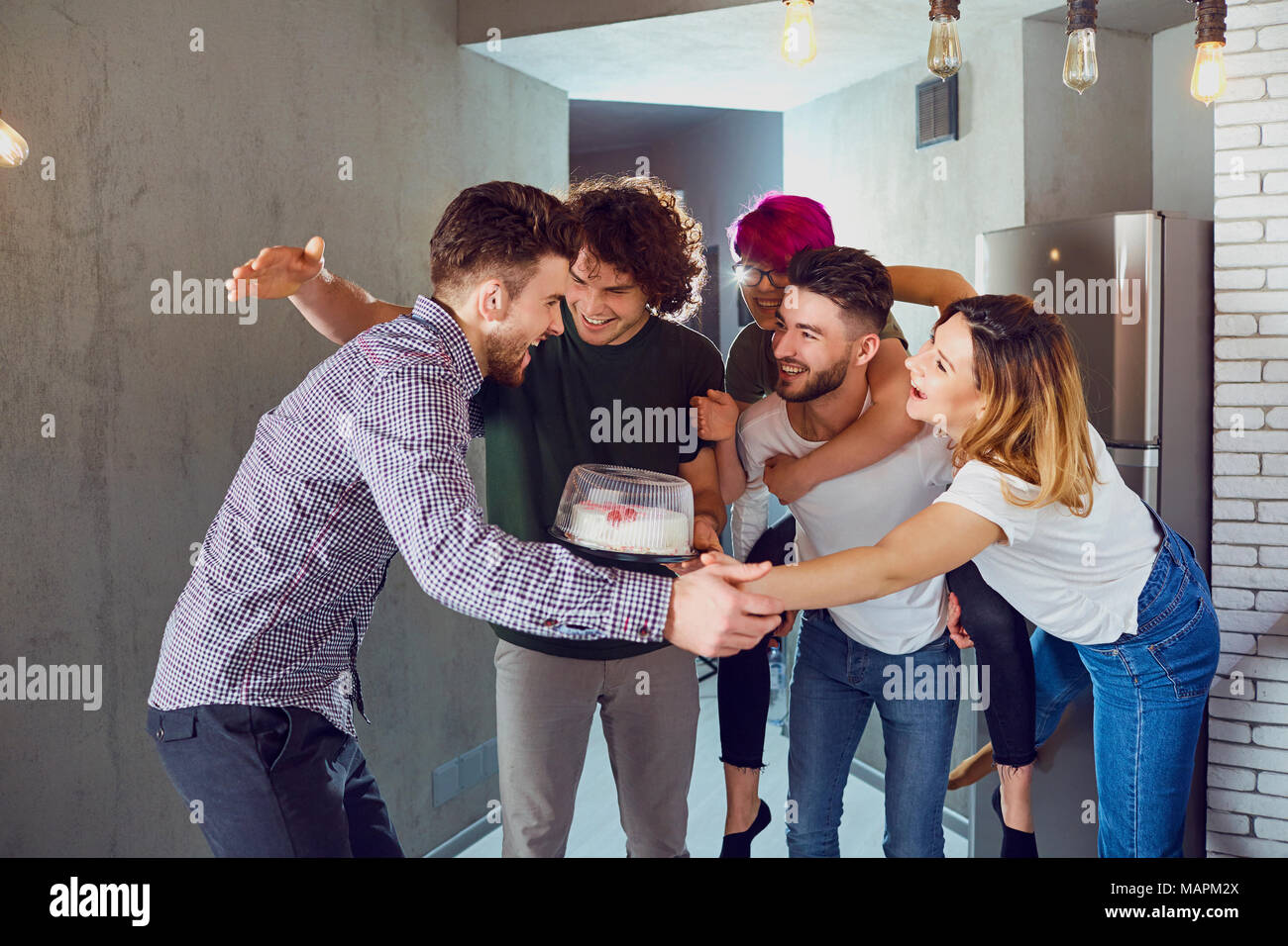 Group of friends of guests came to the other at the meeting.  - Stock Image