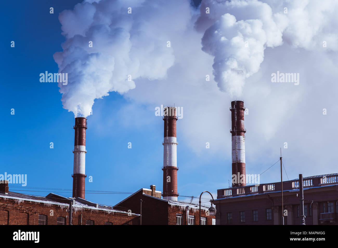 Thermal power plant pipes erupt smoke into the air in St. Petersburg, Russia - Stock Image