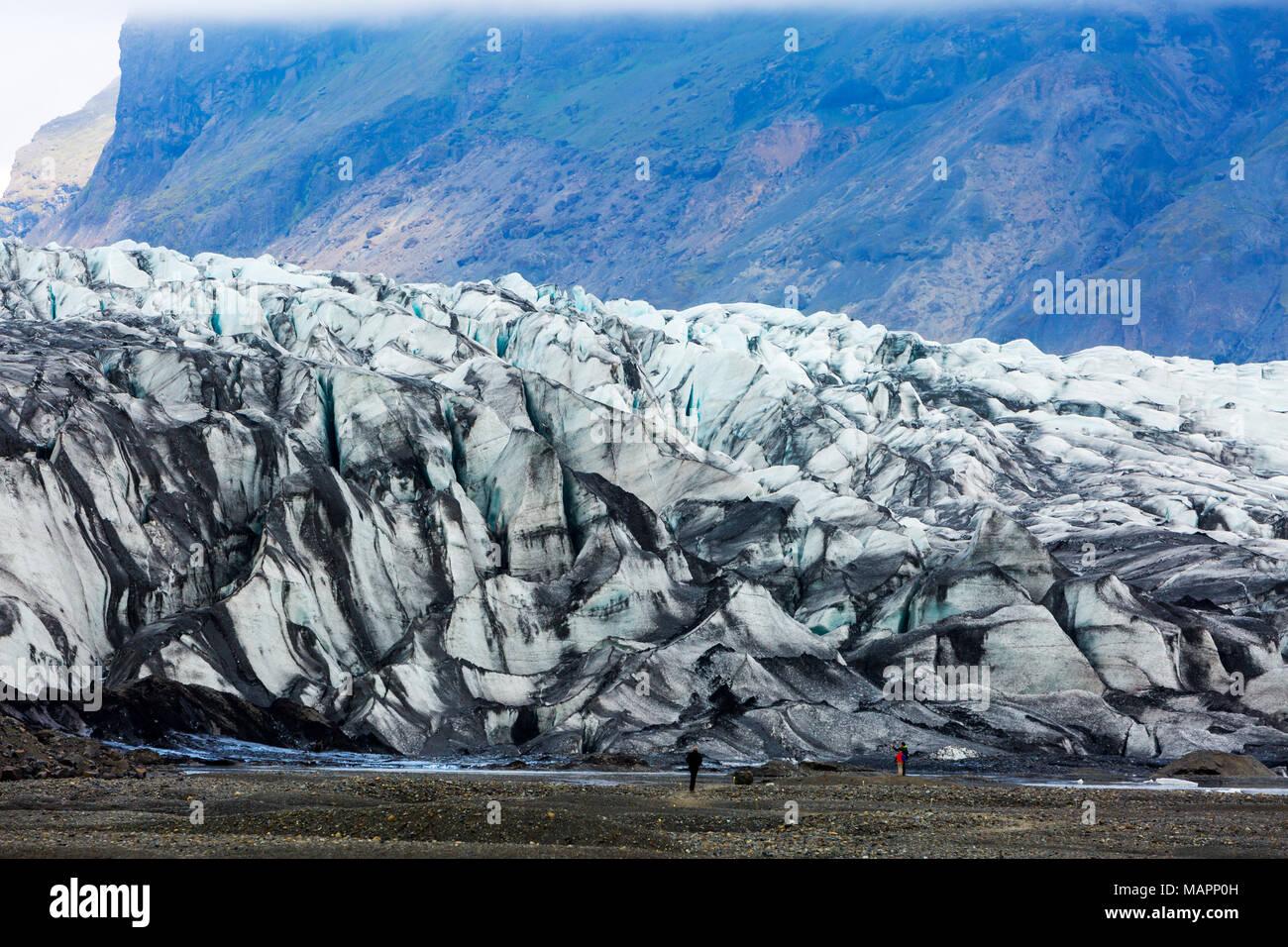 ash covered Skaftafellsjokull glacier, Vatnajokull National Park, Iceland - Stock Image