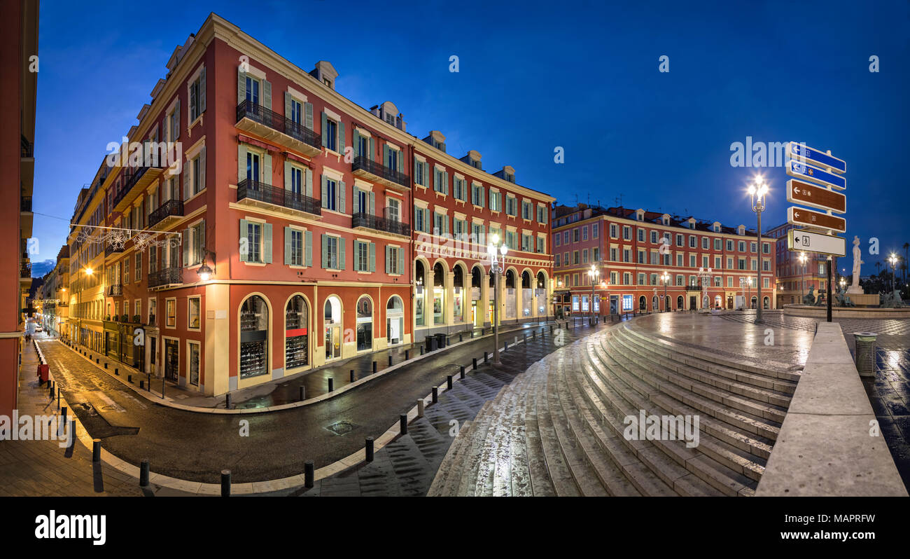 Place Massena square with red buildings at dusk in Nice, France - Stock Image