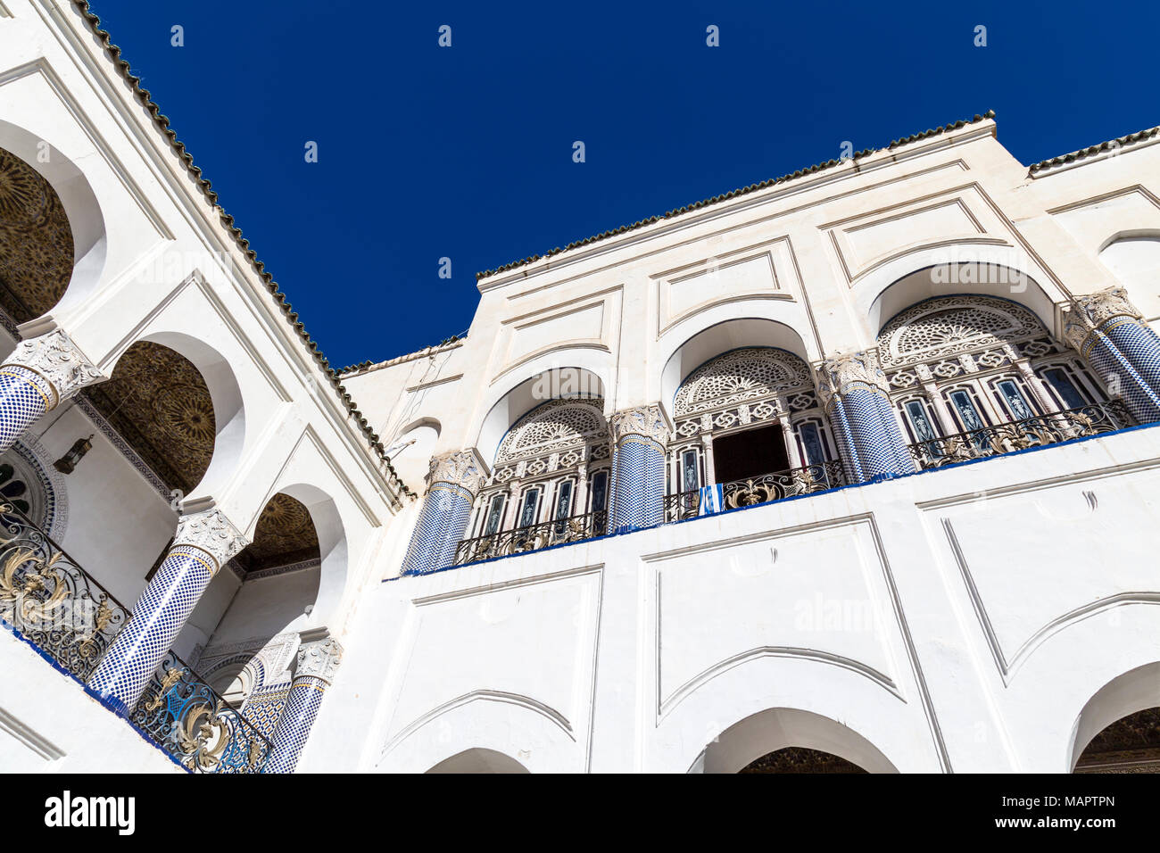 Detail of oriental architecture of a Moroccan palace, with arches, columns and mosaic tile decorations, Palais El Mokri, Fes, Morocco Stock Photo