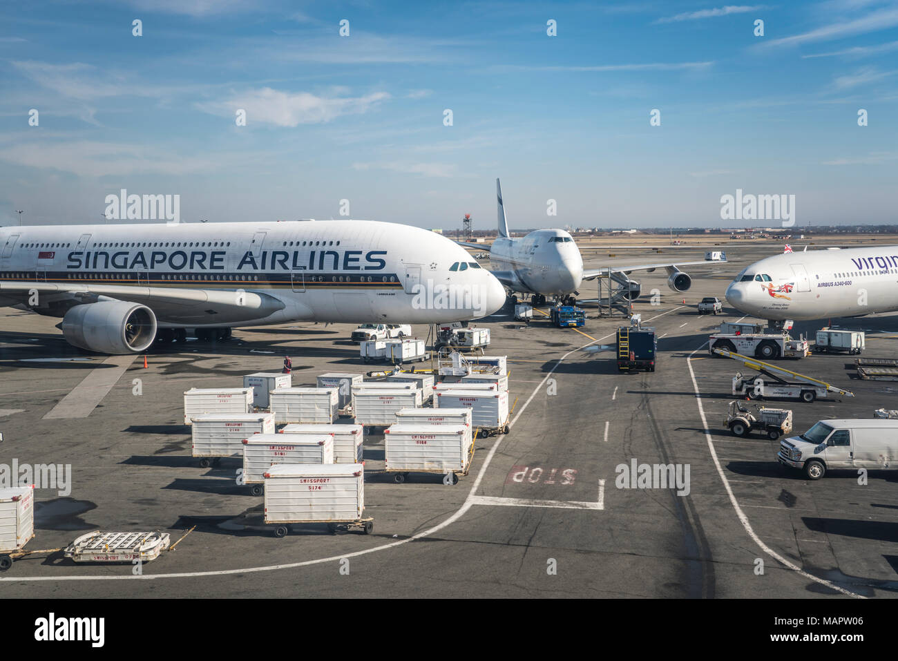 A singapore airlines passenger plane at jfk international airport in a singapore airlines passenger plane at jfk international airport in new york ny usa publicscrutiny Gallery