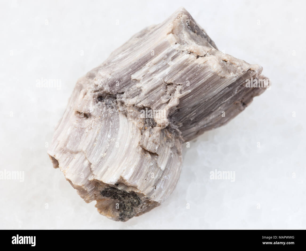 macro shooting of natural mineral rock specimen - piece of baryte stone on white marble background from Irkutsk region, Russia - Stock Image