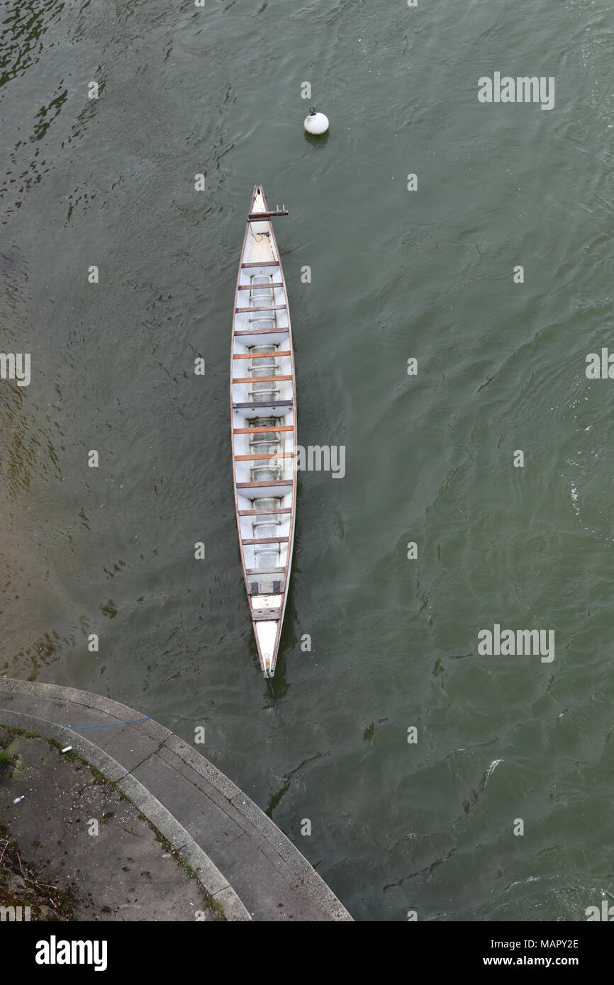 Long white rowing boat on the River Rhine, view from above, Basel - Stock Image