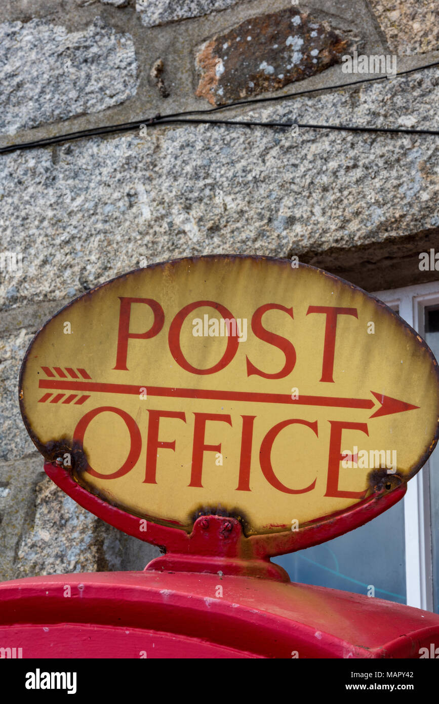 traditional or heritage vintage general post office enamel sign on the top of a post box or posting box in st ives, cornwall. - Stock Image
