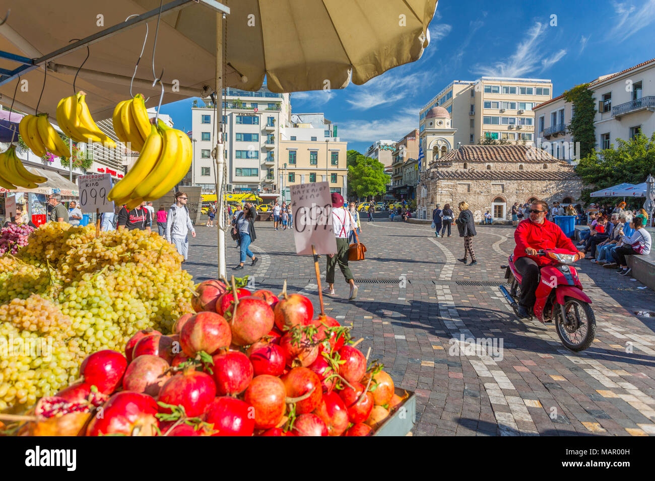 View of fruit stall and Greek Orthodox Church in Monastiraki Square, Monastiraki District, Athens, Greece, Europe - Stock Image