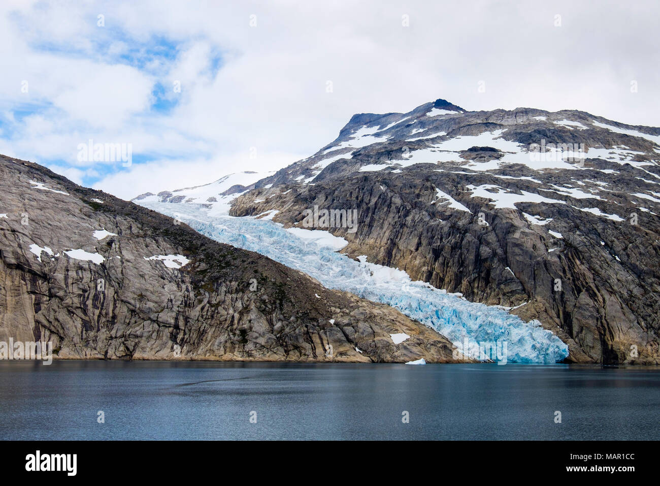 Head of a glacier calving into Prince Christian Sound (Prins Christians Sund) in summer, Kujalleq, Greenland, Polar Regions - Stock Image