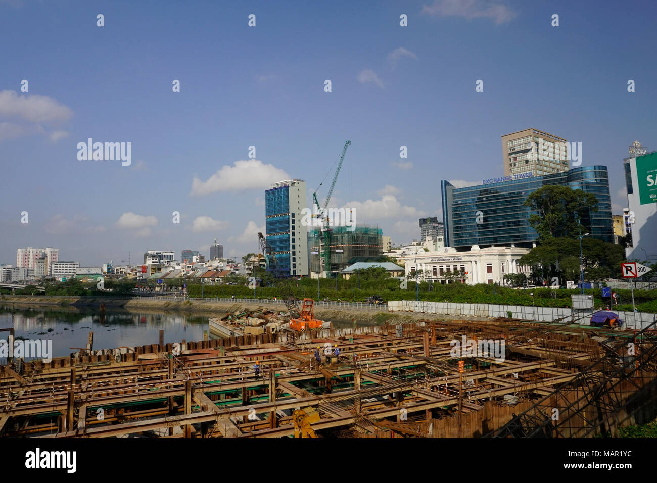Flood & waste rwater  control structure being built next to the Cau Mong Bridge & Rach Ben Nghe canal, a tributary of the Saigon River, District One - Stock Image
