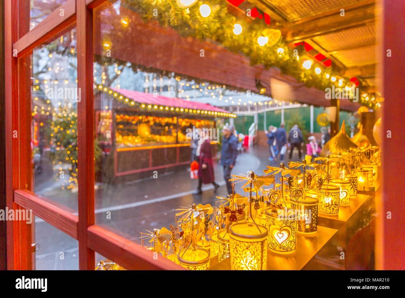 Christmas Market Stalls and shoppers in Leicester Square, London, England, United Kingdom, Europe Stock Photo