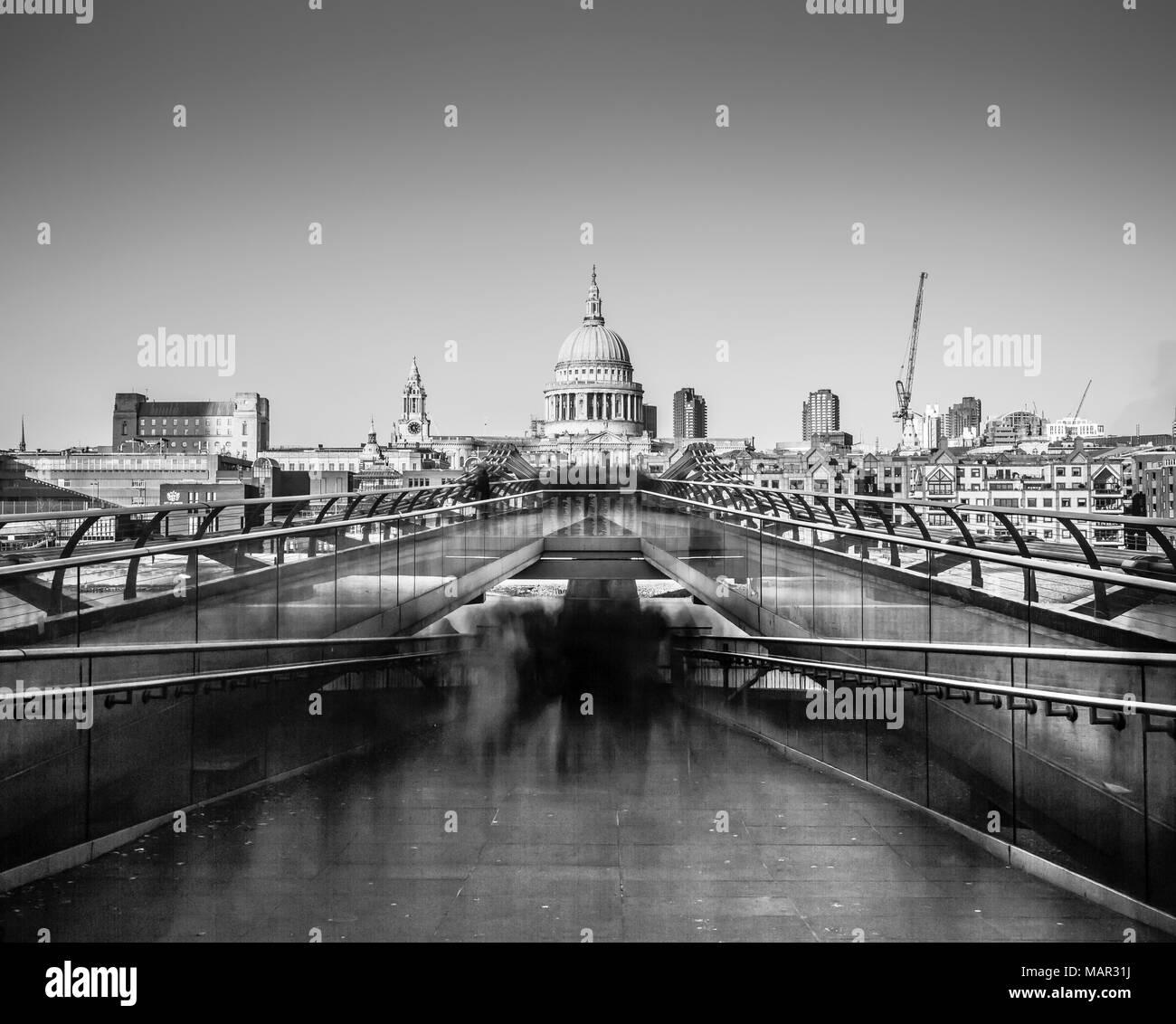 Ghostly figures going to work in long exposure image of St. Paul's from Millennium Bridge, City of London, London, England, United Kingdom, Europe Stock Photo