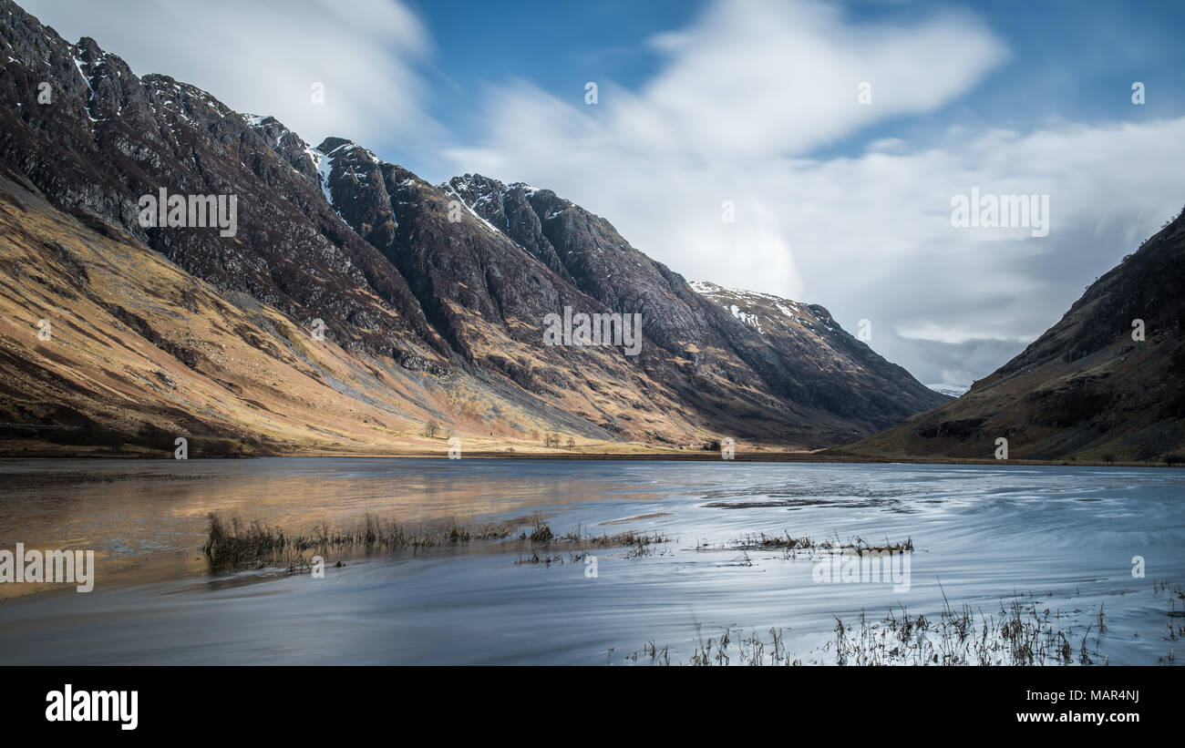 Loch Achtriochtan in Glencoe in the Scottish Highlands with the Aonach Eagach ridge line in the background - Stock Image