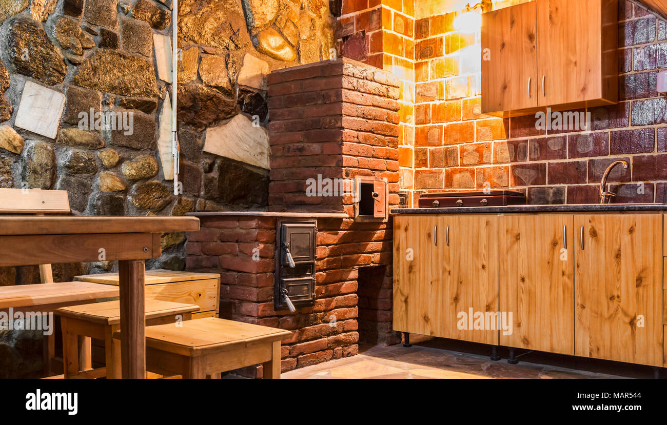 Rustic Kitchen With Wooden Furniture And Brick Oven In A Chalet Stock Photo Alamy