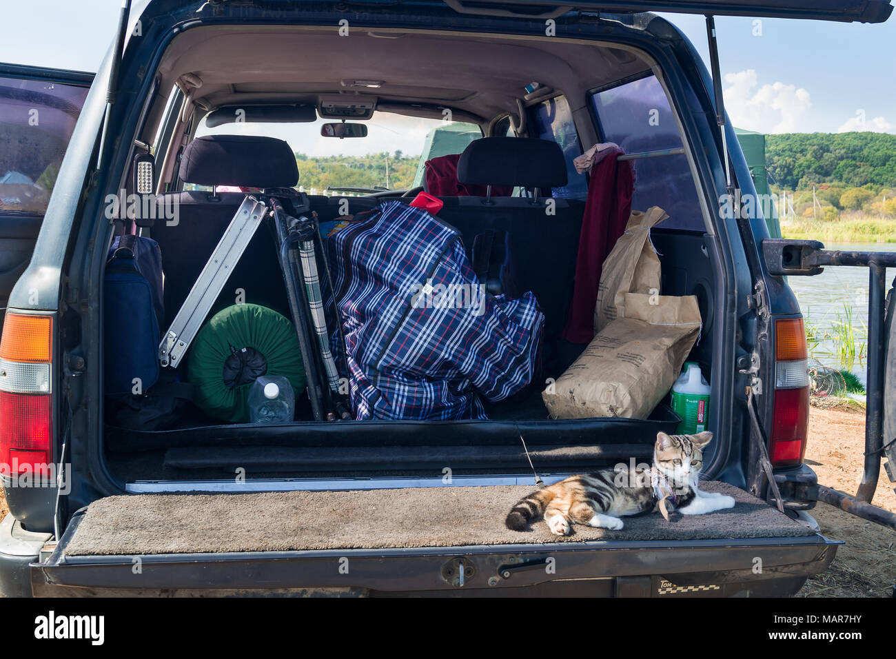 Things in the trunk of the car are prepared for transportation and travel on vacation - Stock Image