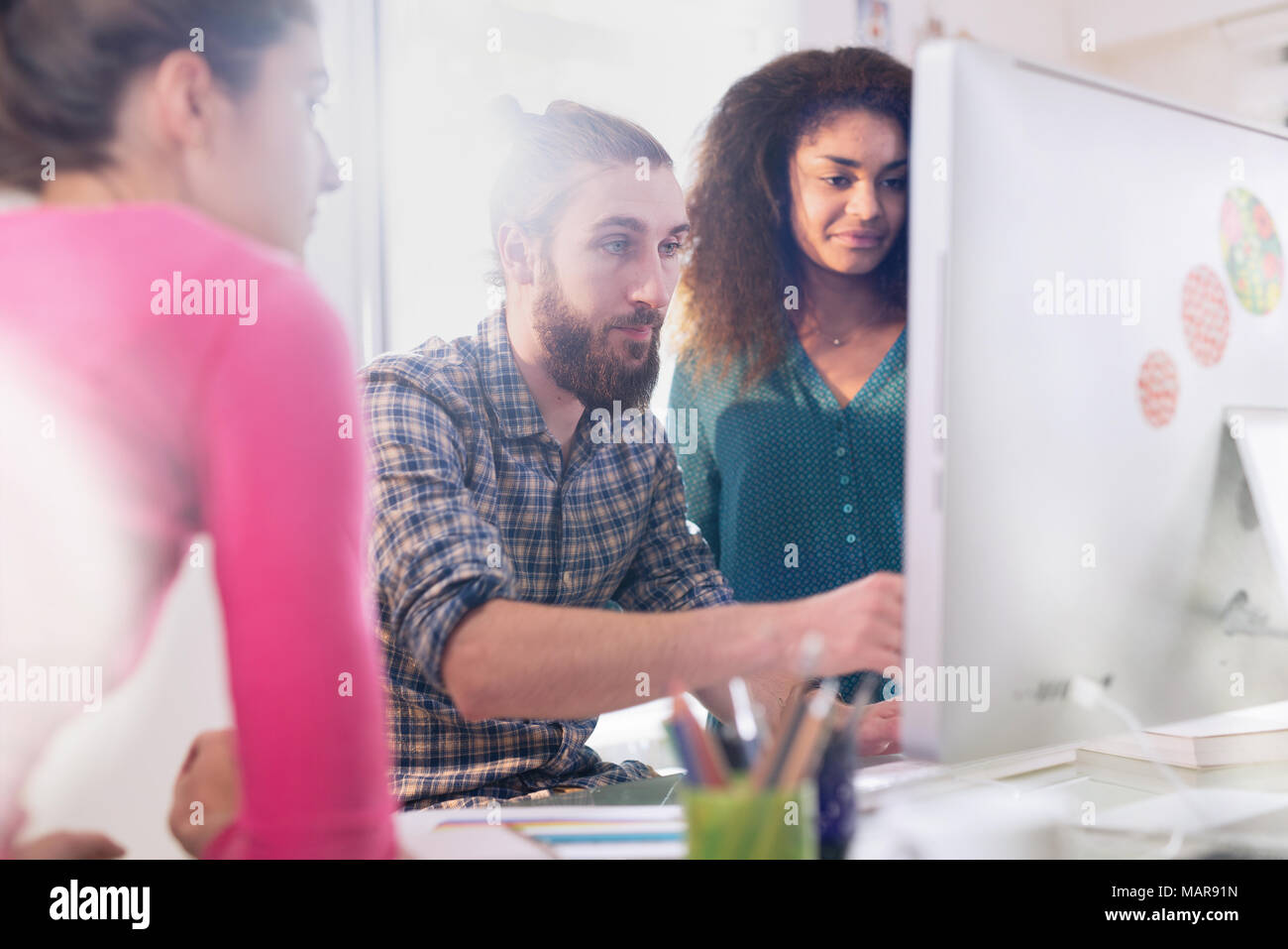 At the office young creative and multi-ethnic team is at work - Stock Image
