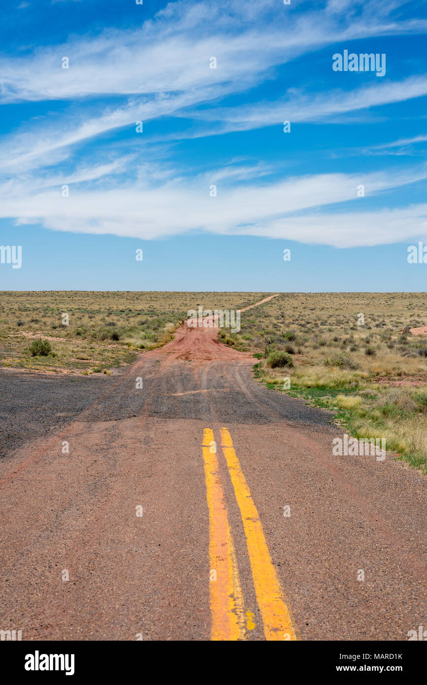 End of  paved road. Dirt road ahead. Desert - Stock Image