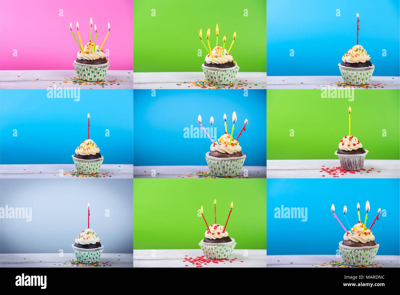 Big set of Birthday cupcake on a color background with multicolor candles. - Stock Image