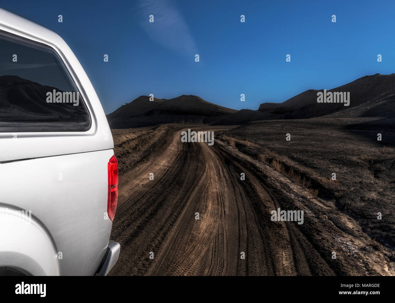 Off roading:Truck in the muck.Modern 4x4 with camper in the mud hills of S.E. Utah - Stock Image