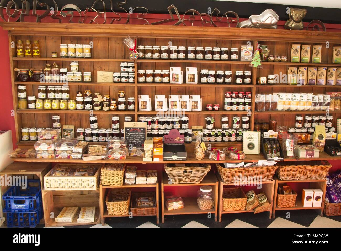 Wooden Shelving Inside A Shop Displaying Jams Chutneys And Biscuits