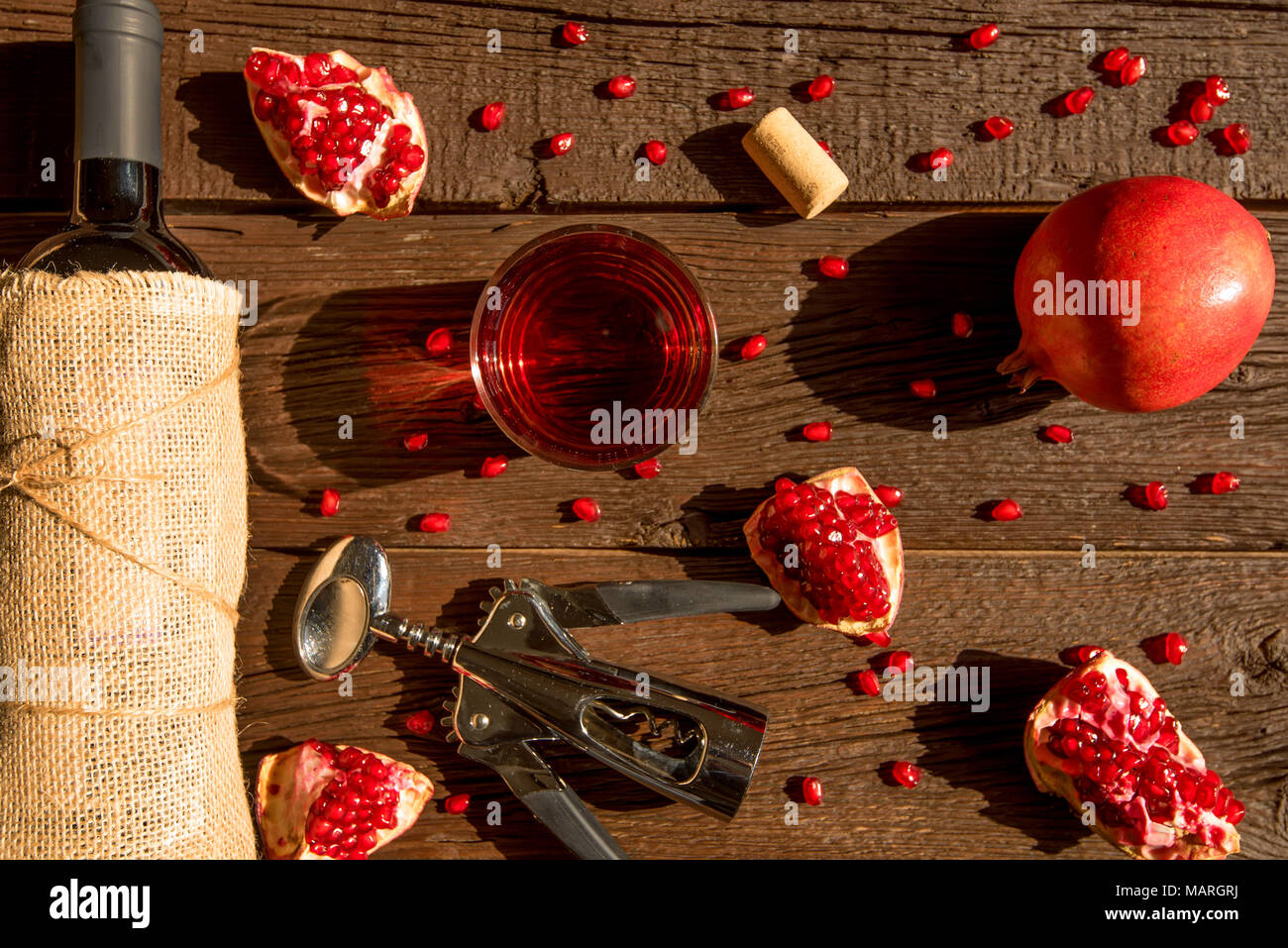 Top view pomegranate wine, bottle opener and fruit Stock Photo