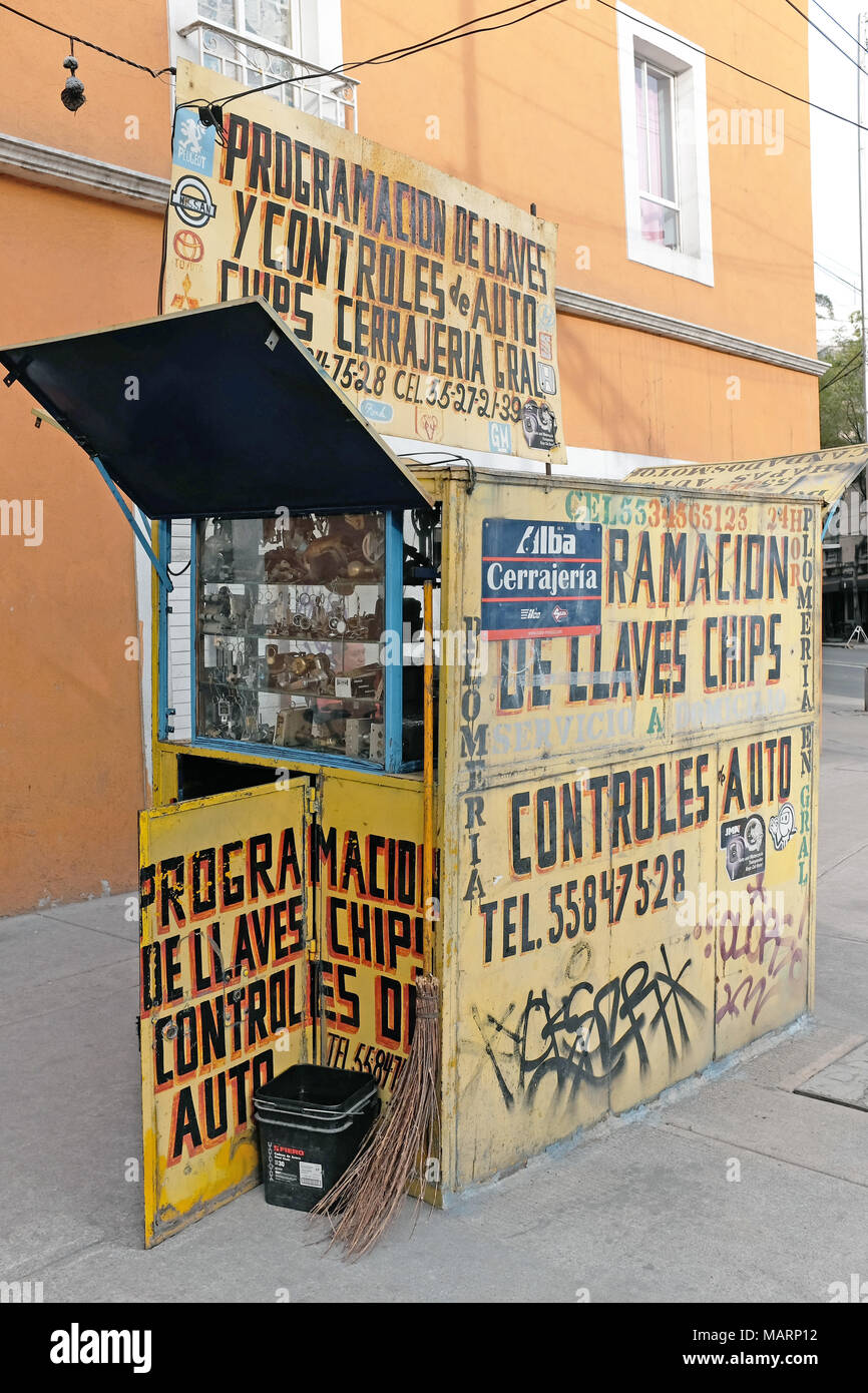 A sidewalk locksmith stand in Mexico City, Mexico, specializing in keys and locks is an old fashioned type of pop-up business. - Stock Image