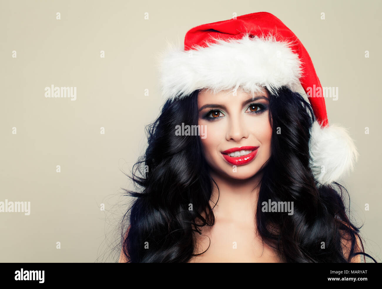 Christmas Model.Beautiful Christmas Woman In Santa Hat Smiling On Banner