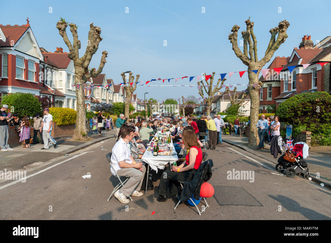 Road closed for neighbourhood street party during national bank holiday in Hornsey, North London, UK - Stock Image