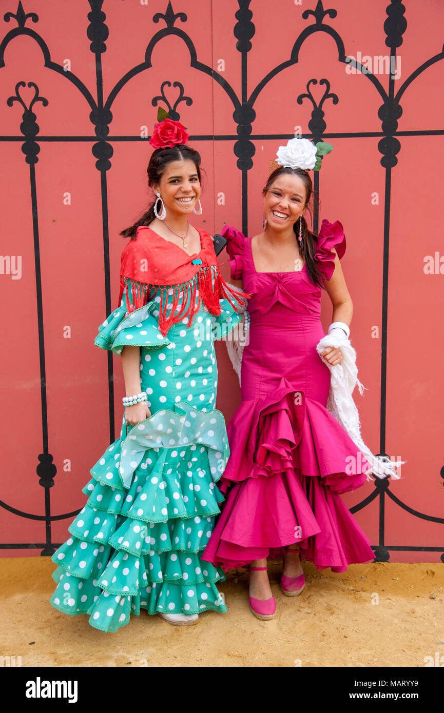 0b9acd9d2d1 Beautiful young women dressed in colourful flamenco dresses at the Seville  April Fair