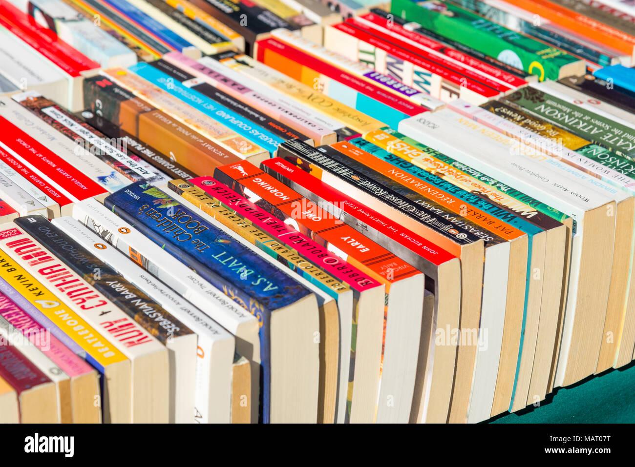 Paperback books for sale on market stall, UK - Stock Image