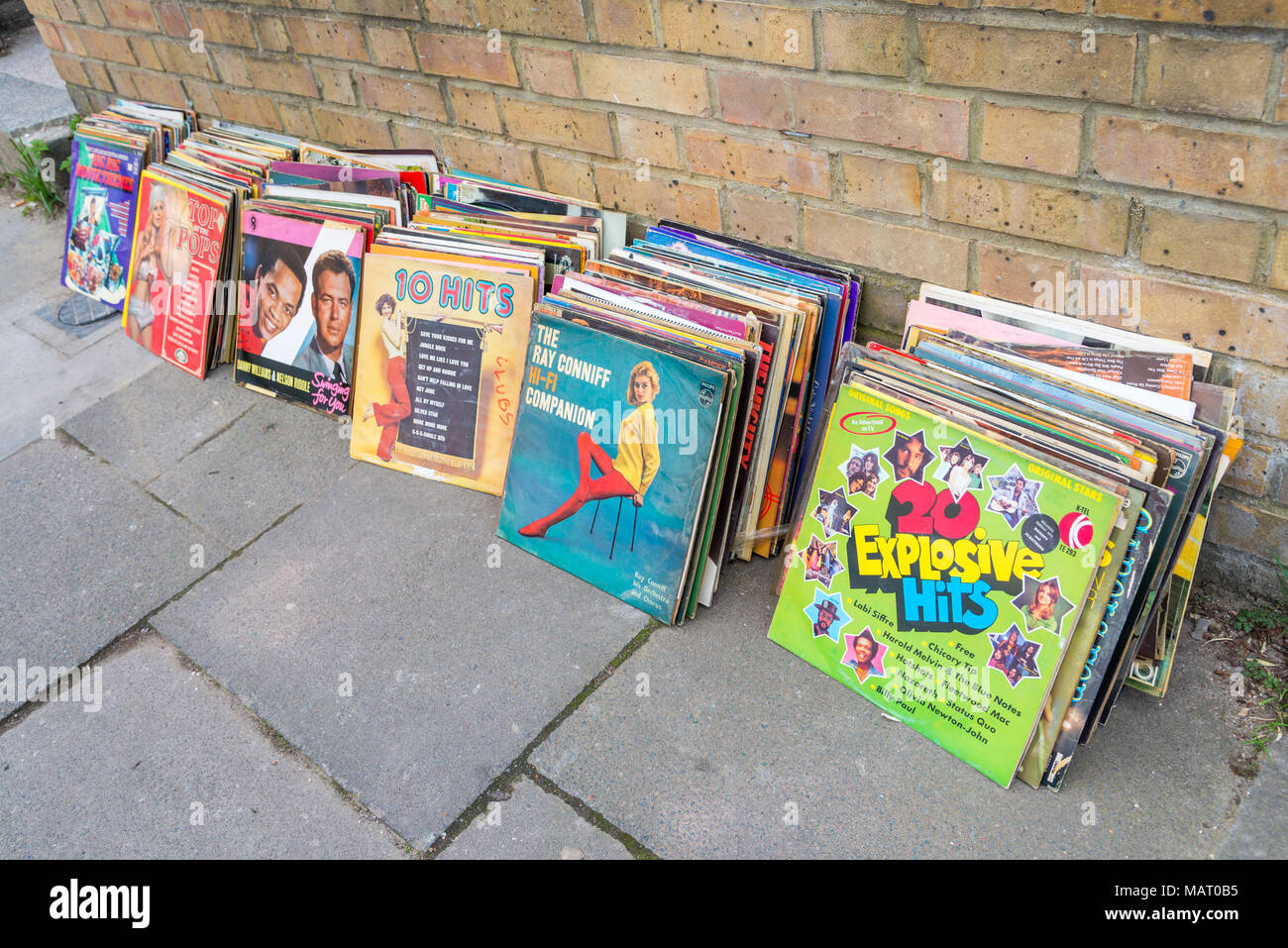 Old vinyl LPs left out in the street for people to help themselves, UK, London - Stock Image