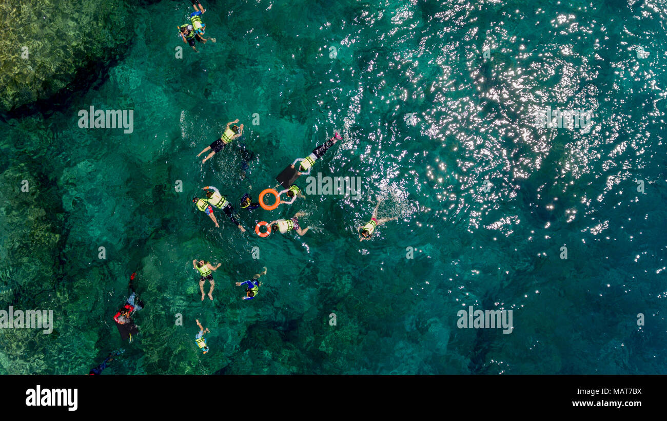 Aerial Photo Of People Snorkeling In Tropical Coral Reef Similan Island Thailand