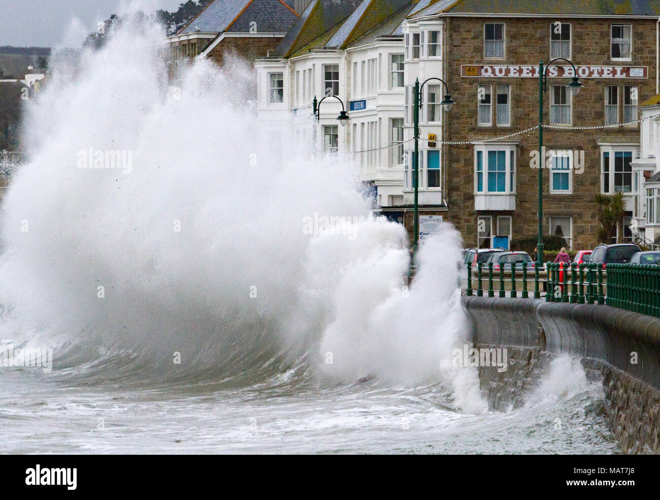 Penzance, Cornwall, UK. 4th April 2018.  A fast moving late winter storm brings waves as high as three storey hotels to the south west coast as Britain struggles to move properly in to Spring. Credit Mike Newman/Alamy Live News Stock Photo