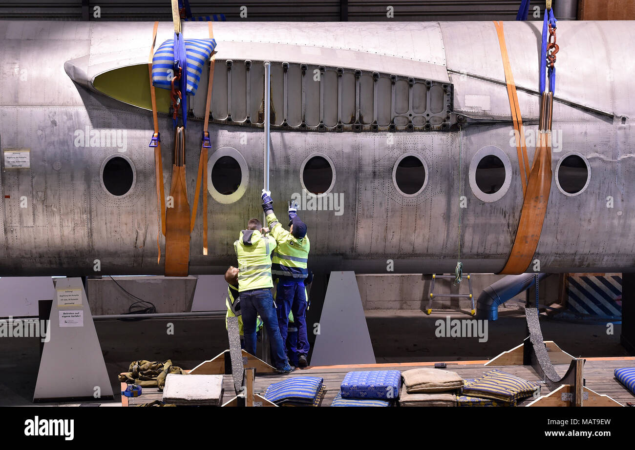 04 April 2018, Germany, Dresden: The hull of the aircraft 152 being transferred in a hangar of the Dresden International Airport. The Baade 152 was the first German commerical aircraft with jet propulsion and was since 2001 in a museum at its previous location. Photo: Matthias Rietschel/dpa-Zentralbild/ZB - Stock Image
