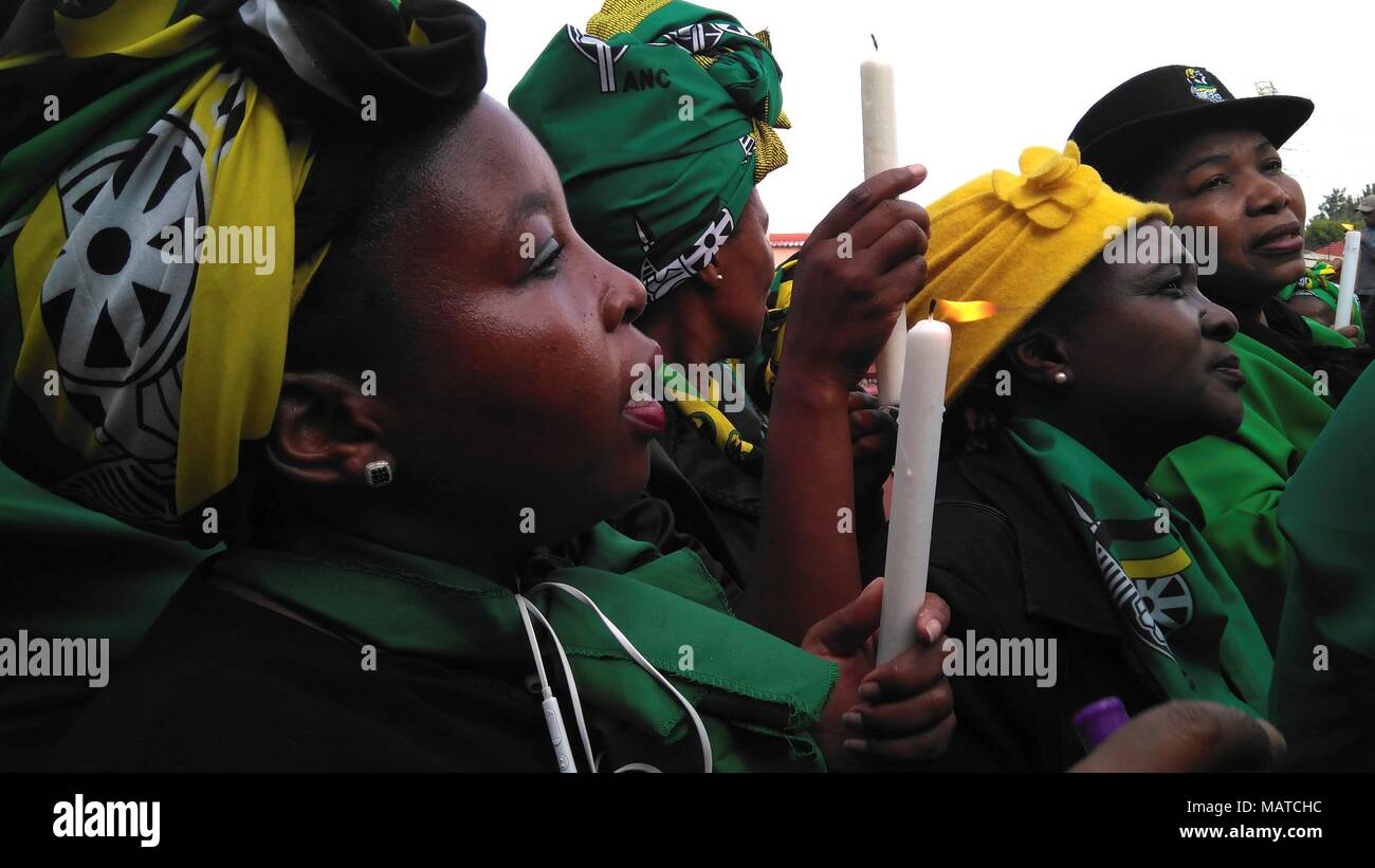 Women of the Nationa African Congress pay tribute to Winnie Madikizela-Mandela after her recent death during a march to her house in Soweto, South Africa, 04 April 2018. Known as 'the mother of the nation', the iconic leader who fought against racial segregation and second wife of the first South African black president Nelson Mandela, passed away past Monday at the age of 81, at the Netcare Milpark hospital in Johannesburg. EFE/ Nerea Gonzalez - Stock Image
