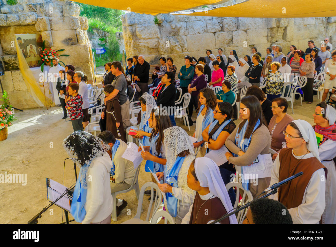 EMMAUS, ISRAEL - APRIL 2, 2018: Easter Monday Solemn Mass at the basilica of Emmaus-Nicopolis, with the Nuns and prayers, Israel. Commemorating Jesus  Stock Photo
