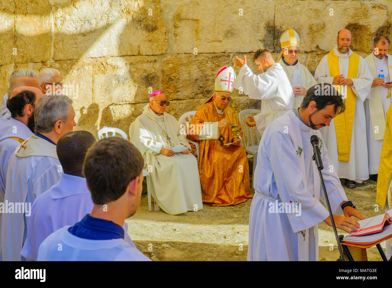 EMMAUS, ISRAEL - APRIL 2, 2018: Easter Monday Solemn Mass at the basilica of Emmaus-Nicopolis, with the Latin Patriarch of Jerusalem and other priests Stock Photo
