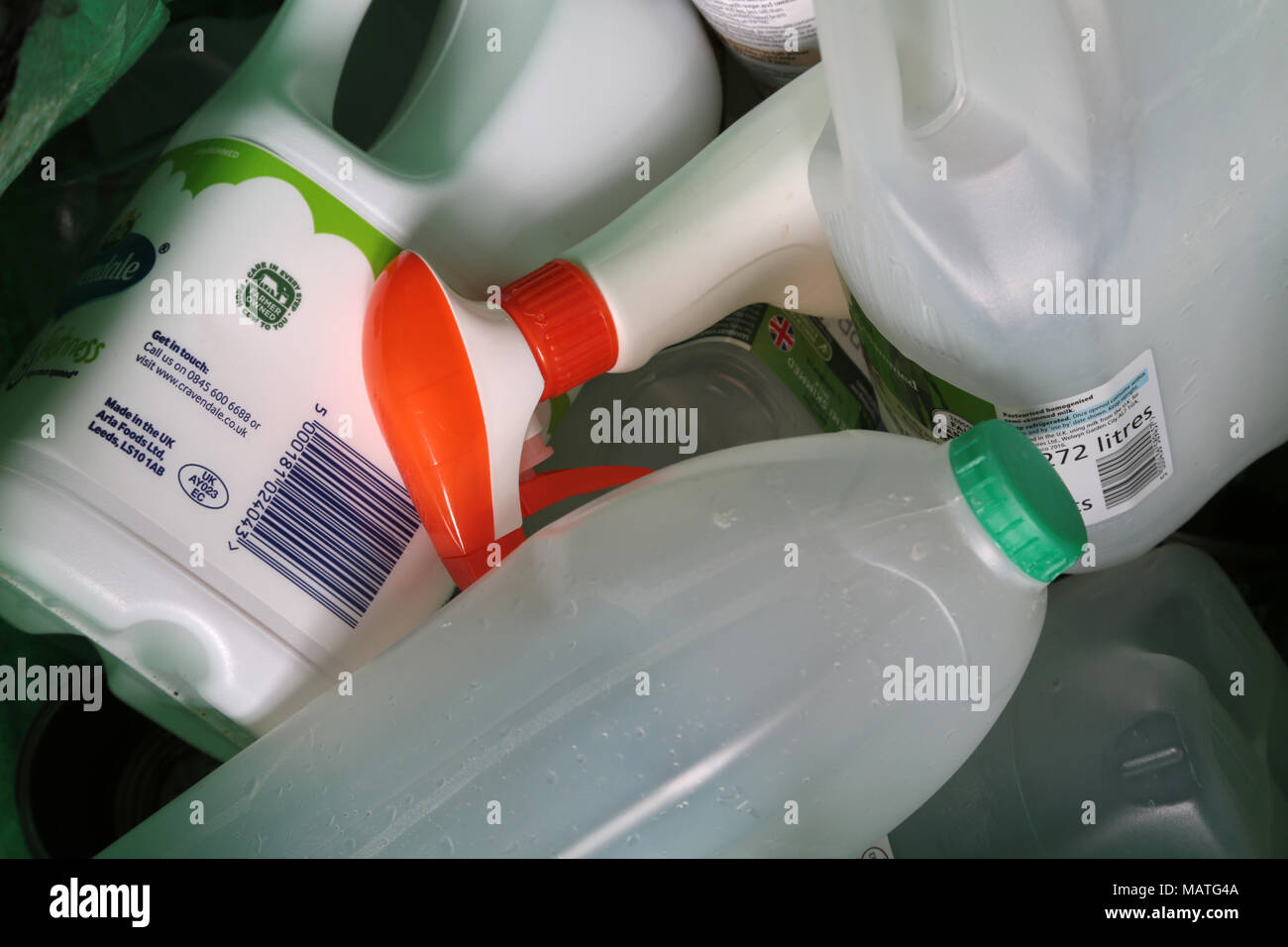 Plastic containers in a household recycling bin ready for collection in the uk. Stock Photo