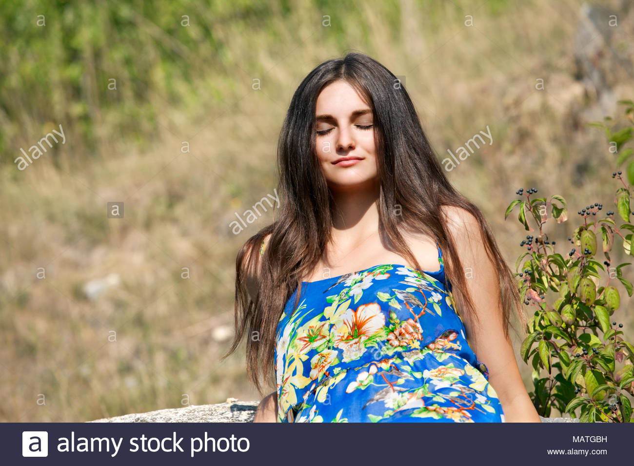Young woman brunette, 20 years old, basking on the sun. - Stock Image