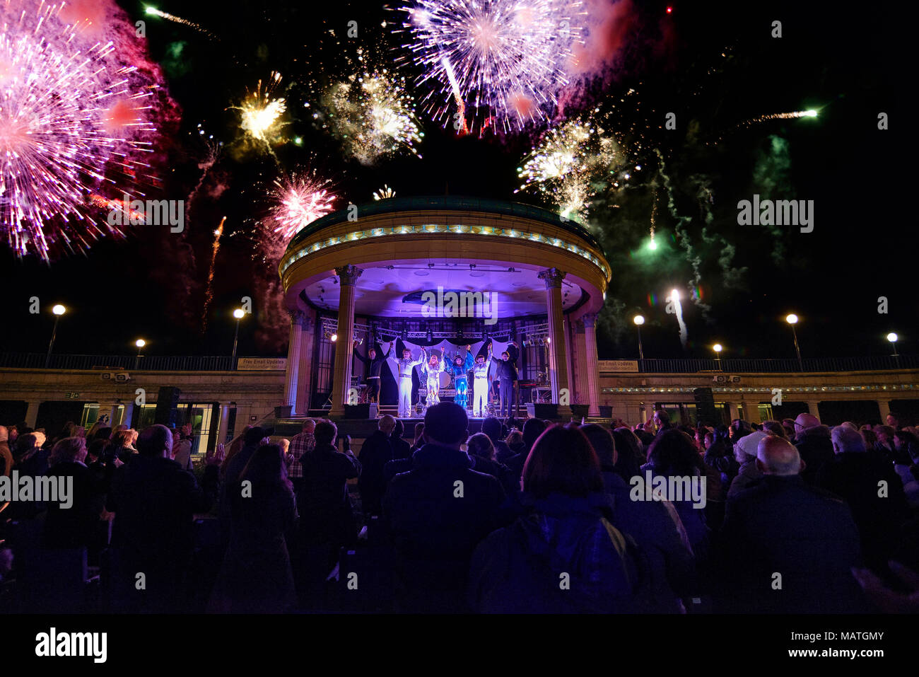 Abba tribute act at the bandstand, Eastbourne, East Sussex, England, UK - Stock Image
