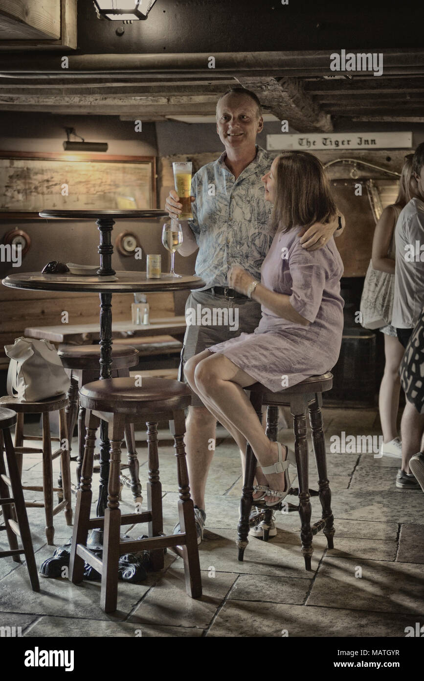 A couple inside The Tiger Inn, East Dean, East Sussex, England, UK - Stock Image