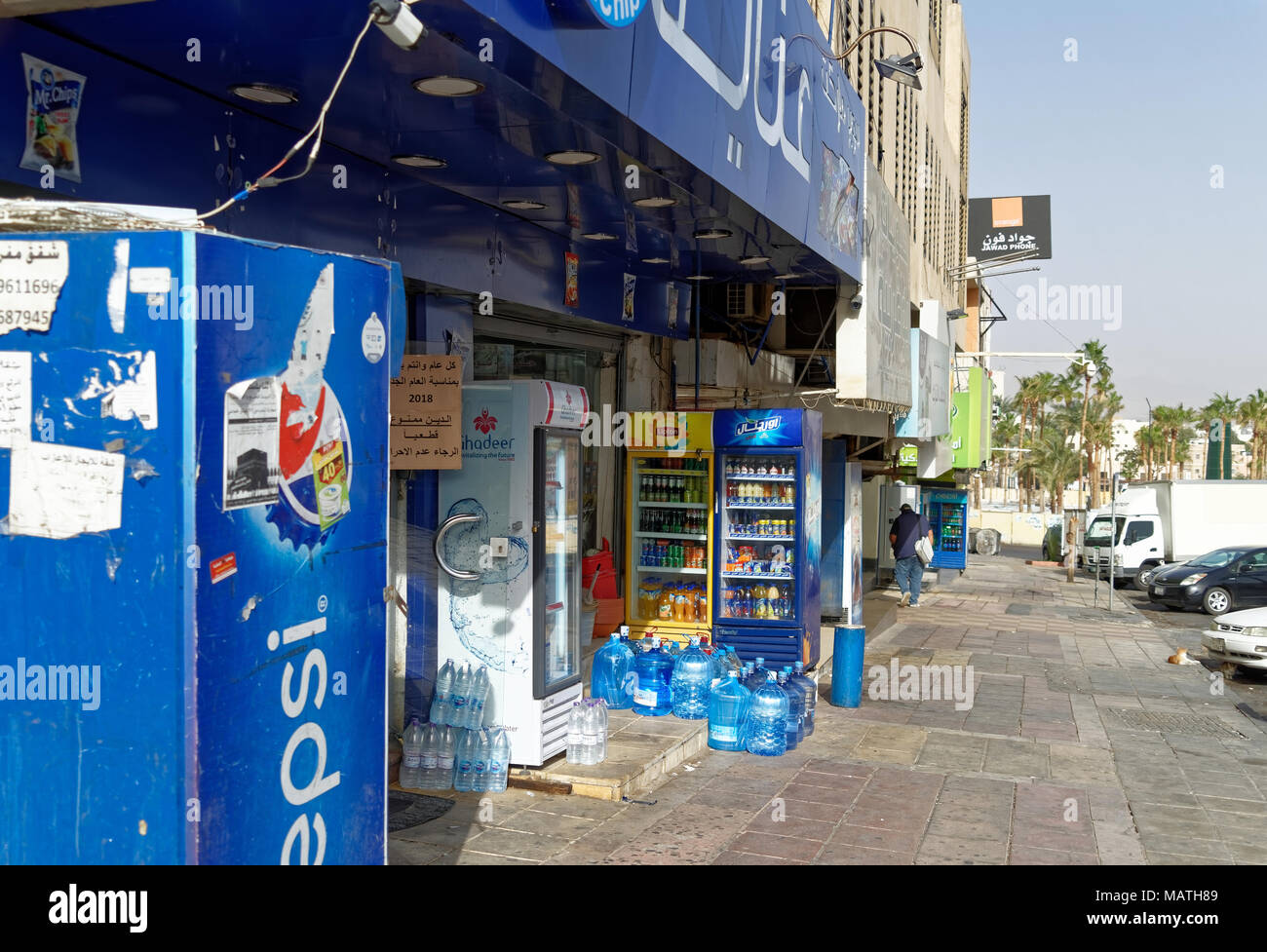 Aqaba, Jordan, March 3, 2018: Small general store that placed its beverage warehouse on the street, in the side street of a suburb of Aqaba, middle ea Stock Photo