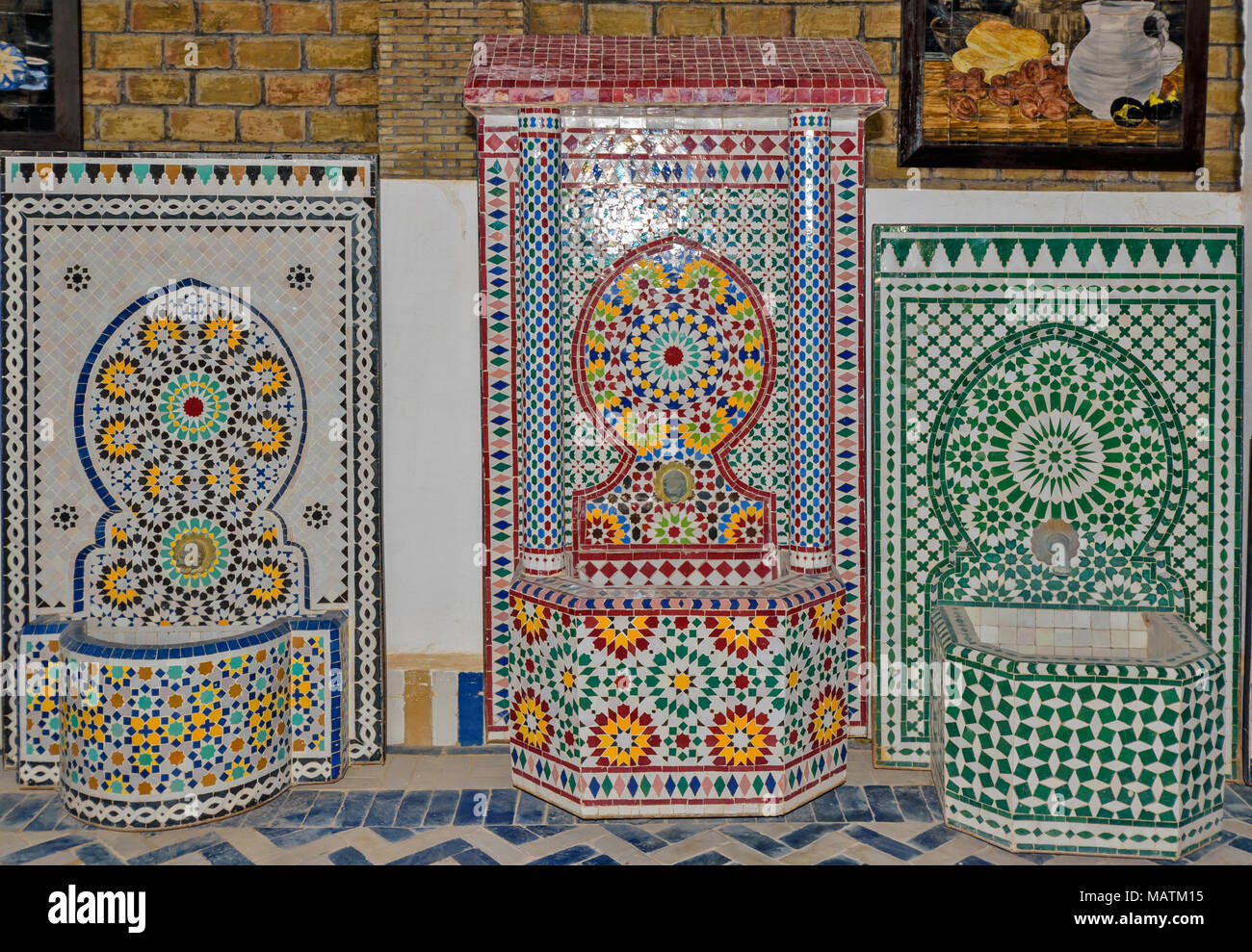 MOROCCO FES MEDINA SOUK ART NAJI FAMOUS BLUE HAND MADE POTTERY  ART MOSAIC PATTERNS AND MOSAIC DESIGNS ON SCREENS AND WATER BOWLS - Stock Image