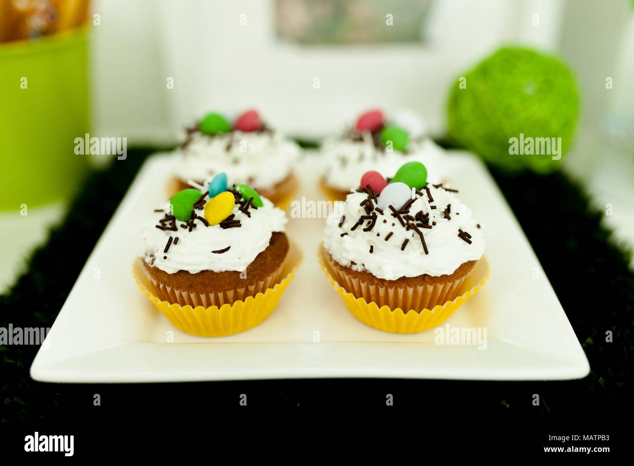 Cupcakes with colored on a white plate Stock Photo