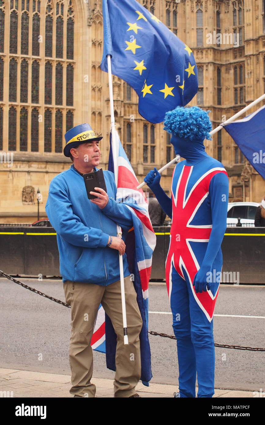 Two men demonstrating against Brexit outside the Houses of Parliament, London - Stock Image