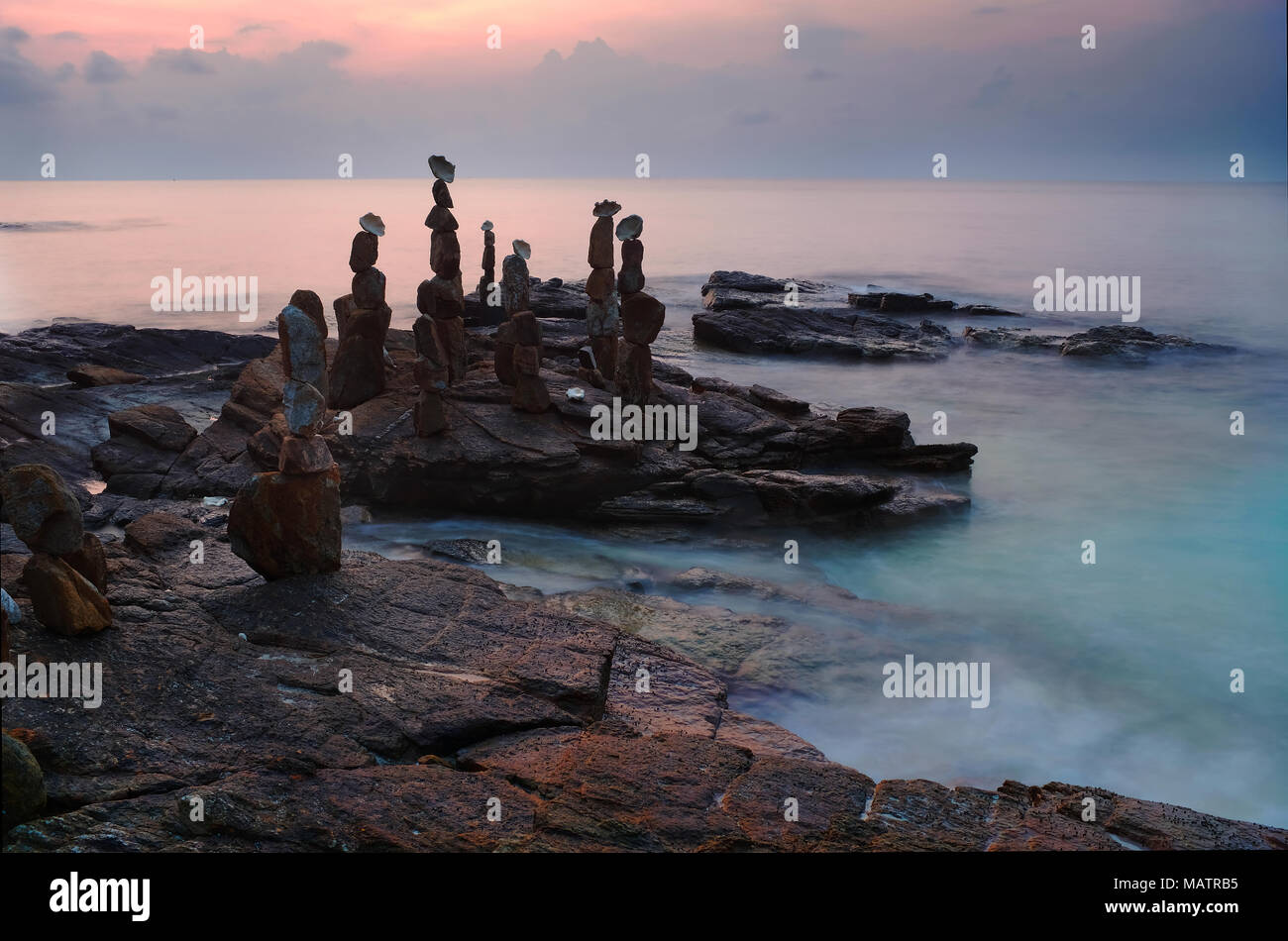 Balanced stones on foreshore, Ko Samed - Stock Image