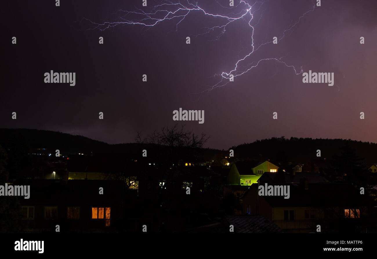 Flash in the spring thunderstorm over the city. - Stock Image