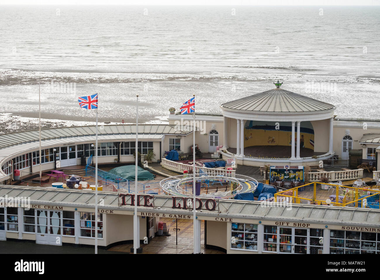 view looking down onto worthing lido  ( now amusements park) with the sea behind on a windy day. - Stock Image