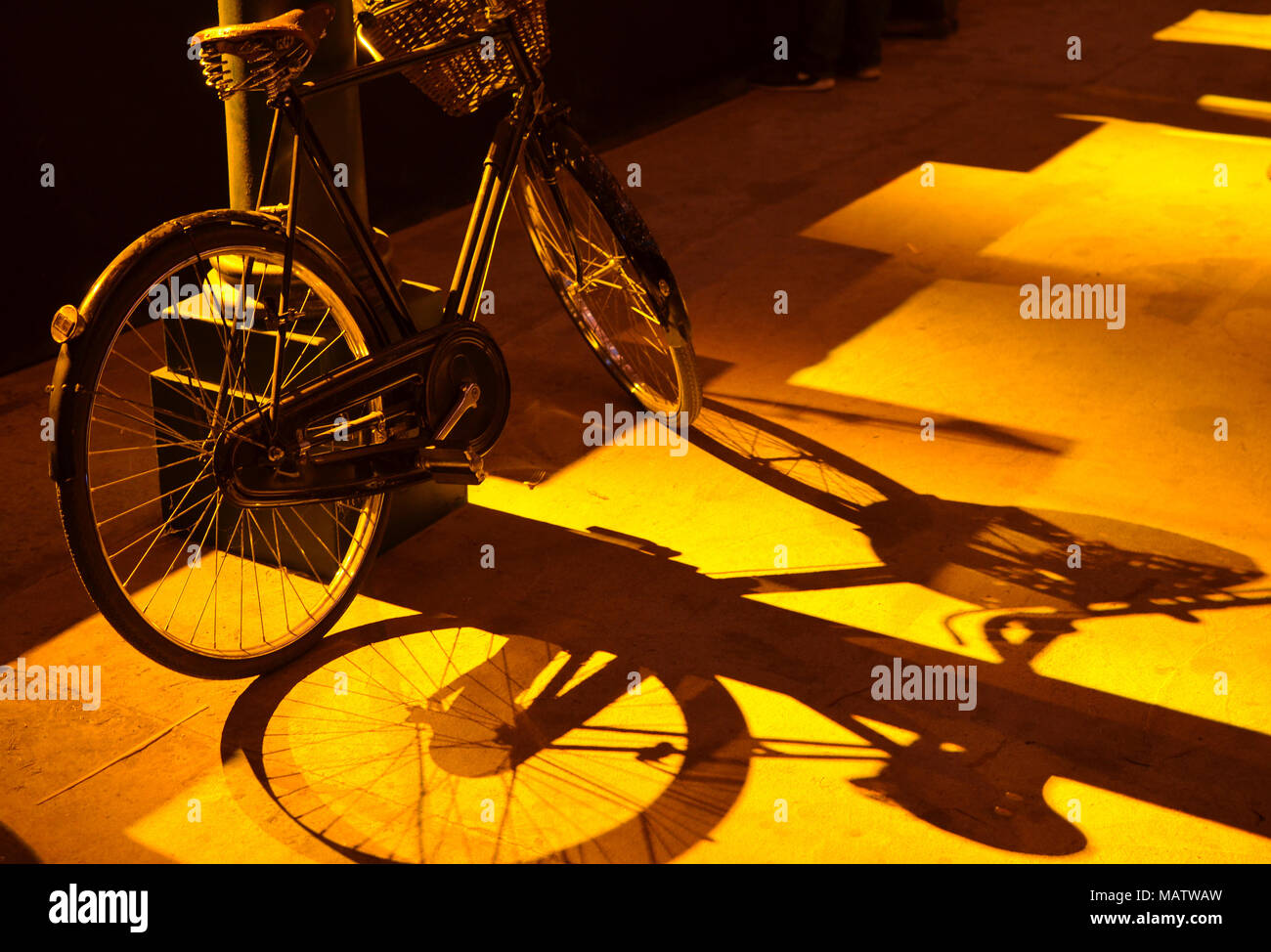 Ladies bicycle leant against a street light at the evening celebrations at the 73rd Goodwood Members Meeting. - Stock Image